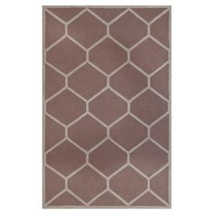 Wool rug with a trellis motif. Hand-tufted in India.        Product: RugConstruction Material: Wool...