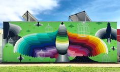 okuda san miguel covers kindergarten in arcugnano, italy with playful faces