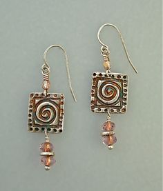 jewelry image of Handmade fine silver charms with czech glass beads on sterling wires.