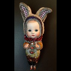 Beth by Betty Youngquist via Etsy - Materials: antique doll parts, antique glass doll eyes, coral, glass beads, glass stones, mosaic, beadwork, assemblage, mink, repurposed fur