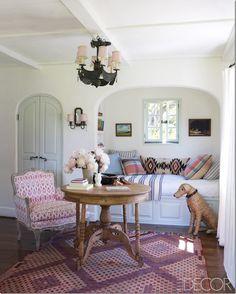 Pinks, rug and soft green door.  Kathryn Ireland Fabrics