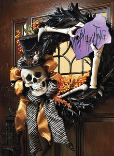 Mesmerize visitors at your door with an eerily elegant swirl of black feathers graced by the presence of a mischievous skeleton and his purple sign.