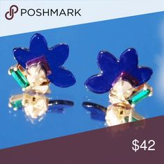 """Wanderluster New York Aksama Stud Earrings Blue Wanderluster New York Aksama Pierced Stud Earring in Blue, NEW, Retail Price $75.  Signature white climbing rose design features custom cut petal crowns and a reverse set emerald-colored center stone. Petal measures 7/8"""". Unique pyramid shaped earring backs, also plated in yellow gold.  Materials: Blue Resin petal & Yellow Gold Plated Brass. Packaged in grey velvet pouch with metallic silver logo.   Thanks for looking and please browse my other…"""