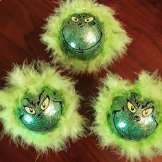 How The Grinch Stole Christmas Tree Ornament This listing is for a handmade Grinch ornament with premium Oracal 651 vinyl on a glittered 3 Glass ball, wrapped in green feather boa. The hanger loop on the ornament is shiny silver. The glitter is on the inside of the ornament so there