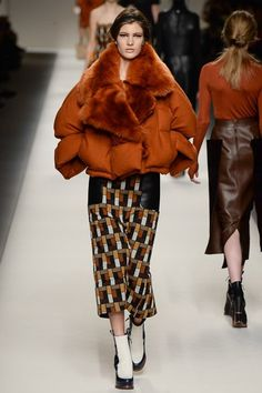 Fendi - Huge, oversize puffer jacket with fur collar and lapels worn with a geo print midi skirt. #fw15 #mfw