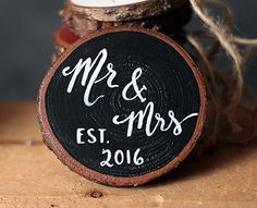 """Mr & Mrs Christmas Wood Slice Ornament, by Our Backyard Studios in Mill Creek, WA.  This rustic wood slice has been painted black, with free-hand lettering in white reading """"Mr. & Mrs., Est. 2016.""""  Perfect wedding gift!"""