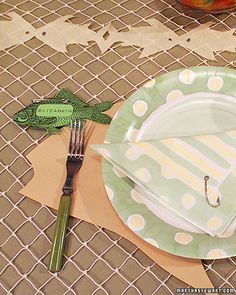 Make fish-shaped streamers, patterned place mats, and a netted tablecloth to extend your party theme.