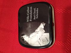 Tin of mints from The Willa Cather Foundation.