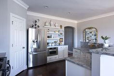 Gina & Michael's Glamorous Builder's Special. Love the color of the marble countertop. #home #interior #kitchen #inspiration