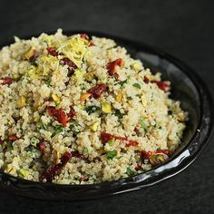 Whip up this vibrant quinoa salad in minutes. Pistachios and sun-dried tomatoes add crunch and color, and the salad is gluten-free and vegan. This is a day to celebrate! Liz of The Lemon Bowl is having a baby boy, and a whole group of bloggers are honoring her and her little one with a virtual baby shower, hosted by Kristen of Dine & Dish, Rachel of Rachel Cooks and Sheila of Eat2Gather. To make the shower truly about Liz, we all made recipes with lemon, true to the name of Liz's blog...