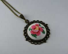 Rose cross stitch necklace by CabbageStitches on Etsy