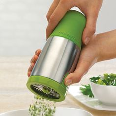 Hundreds of patented, ultra-sharp scissor teeth on this Microplane herb mill finely chop fresh herbs without tearing or blemishing delicate leaves. Twist the soft-touch ergonomic handle to dispense, and keep hands free of aromatic herb moisture. Easy top-fill, large-capacity chamber will also store a generous supply of patted-dry herbs. Blades made in the USA. Dishwasher-safe.Product