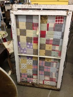 You can use an old cutter quilt, staple it to the back of an window. Wonderful unique piece for you wall.