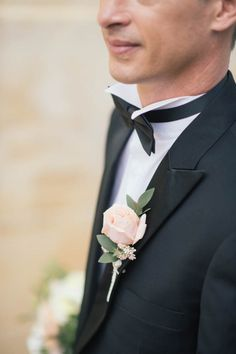 classic black-tie grooms attire with blush boutonniere