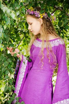 """""""Violet"""" - the dress of historical stylization - has no real historical example, but its prototype is medieval european cotte. Silhouette had been created by masters of the days of yore emphasize grace and delicacy of a woman figure cause these were women beauty standards of the Medieval Europe.      The dress is produced from linen; neck and sleeve edges are trimmed with machine embroidery. A lacing on both sides and back allows to adjust the size of the dress. #medieval dress#etsy"""