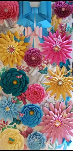 A display for a Mothers Day Corporate Event Paper Bows Paper Flowers Butterflies check out our Etsy shop for our Bow Template, Flower Template, Templates, Large Paper Flowers, Paper Roses, Diy Paper, Paper Crafts, Diy Crafts, Paper Leaves