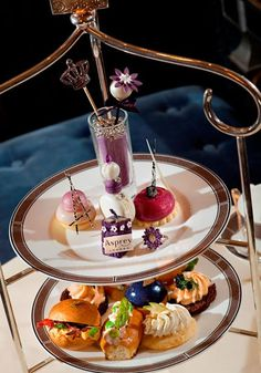 """""""Jubilee High Tea. The Langham has been serving afternoon tea for 140 years, and Asprey dates back to 1781, so we're quite convinced these two brands know a thing or two about British heritage—they collude for a high tea starting at £ 49 per person. Through October [2012].""""  [Slide 10 of 30.]"""