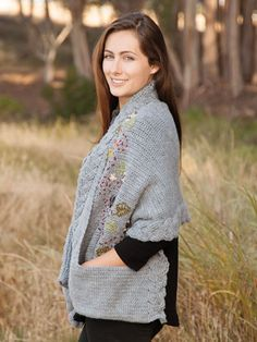 Also featured is a cable trim and deep pockets, making this a lovely classic design. Crocheted using 2 skeins #4 worsted-weight Lion Brand Yarn Pound of Love and 1 packet of Lion Brand Yarn Vanna's Palettes using an I/9/5.5mm crochet hook. Finished m...