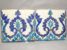 Lot 15 - A pair of C18th Ottoman Iznik Syrian border tiles with repeating scrolling motif in cobalt blue