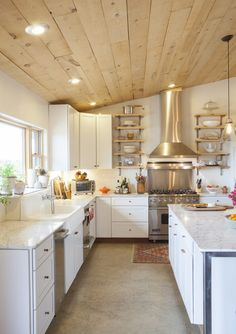 HGTV invites you to take a look at this French country kitchen with a natural wood plank ceiling, stainless steel appliances and polished concrete floors. Wood Plank Ceiling, Wooden Ceilings, Kitchen With Vaulted Ceiling, Kitchen Ceilings, Concrete Kitchen Floor, Kitchen Flooring, Kitchen Wood, Kitchen Cabinets, Concrete Floors In House