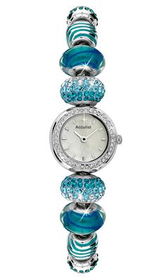 Ladies Charmed Beaded Watch (LB1410)  Blue Lagoon - Charmed by Accurist. Silver Plated bracelet watch with elegant mother of pearl dial and sparkling stone set bezel. This watch includes all beads and stoppers as shown.  £135.00