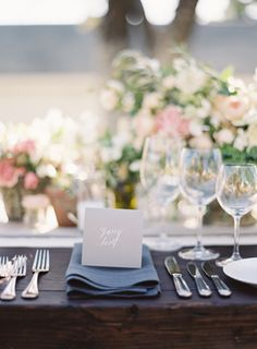 Wooden farm table with charcoal linen napkin, gray place card | French Inspired Sonoma Valley Wedding