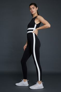 An alternative to a two-piece performance outfit, this full length bodysuit features striping on the outside leg and across the front. Model is and wearing a size small. Bodysuit, Sporty, Gym, Model, How To Wear, Outfits, Fashion, Onesie, Moda