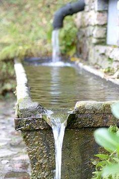 Inspiratie: Het regenwater stroomt in een bak. Als die vol is, mag het verder stromen.