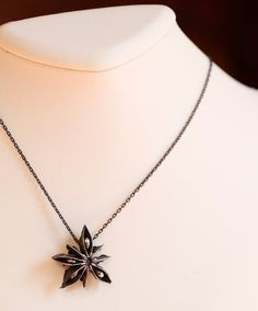 Sterling silver necklace made from a cast star anise pod.