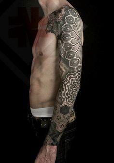 Geometric arm tattoo.