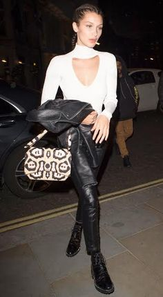 Bella looks great here but this look might be a bit too fashion for most guys! Switch the doc maartens for ballet flats or heels, and stick to a regular white v neck as opposed to Bella's cutout white turtleneck.