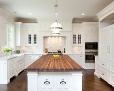 White Marble Kitchen - butcher block island. I would like this even more with stainless steel appliances, stainless steel cannister set, sisal rugs and sisal or jute bowls on the counters.