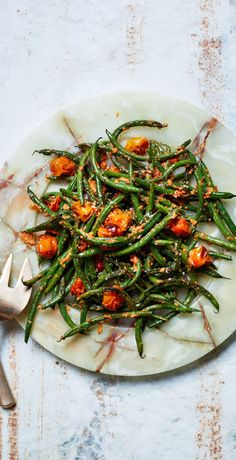 Blistered Green Beans with Tomato-Almond Pesto. This kicky sauce, inspired by Spanish romesco, uses cherry tomatoes.
