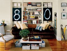 7 rules for small-space living... 4. hang large canvases over shelves to cover messy shelves. These hold work supplies and magazines.
