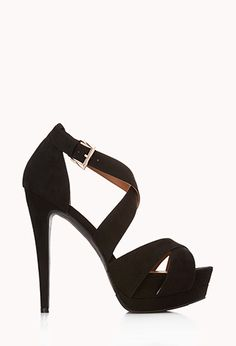 Strappy faux suede platform sandals featuring a stiletto heel. Buckled ankle strap. Padded insole. Textured outsole.
