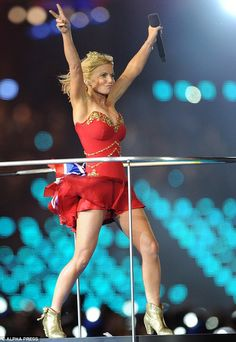 Peace: Geri wowed in a super-short red strapless dress and a gold Halo & Co tiara