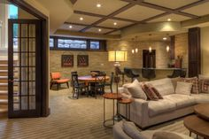 Cozy Family Room Basement Remodeling Ideas With Hidden Ceiling Lamps And Grey Sofa Very Inspiring Family Room In Basement Decorating Ideas