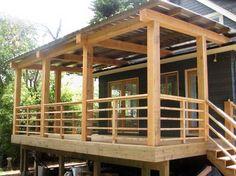 Building Deck Stairs Railing Check out lots of Deck Railing Ideas http://awoodrailing.com/2014/11/16/100s-of-deck-railing-ideas-designs/