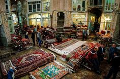 Carpet merchants at old bazaar of Tabriz, Iran.