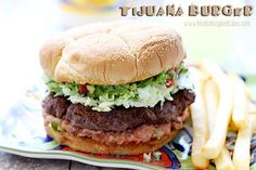 Take your taste buds South of the border with this Tijuana Burger! #burgervention #beef #grilling by lovebakesgoodcakes, via Flickr