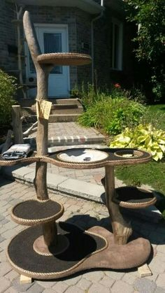 Handmade cat tree--love the incorporation of water and food dishes.  Just add some artificial foliage and some toys and sisal rope for cat scratching needs and this would be fabulous.