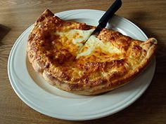 An appetizer calzone is the perfect Italian dish to serve at your dinner parties.