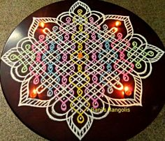 There are lot of Rangoli designs below which are easy and simpl. Indian Rangoli Designs, Rangoli Border Designs, Small Rangoli Design, Rangoli Designs Images, Rangoli Designs With Dots, Rangoli With Dots, Beautiful Rangoli Designs, Simple Rangoli, Rangoli Borders