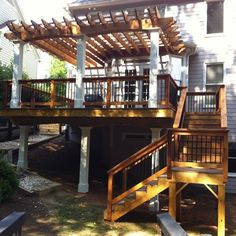 Cedar pergola with finished columns over a composite deck.