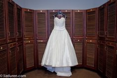 Charleston SC wedding | Dunes West Golf Club | love this shot of the dress against the dark word and texture of the lockers! | Liz Duren Photography » Blog