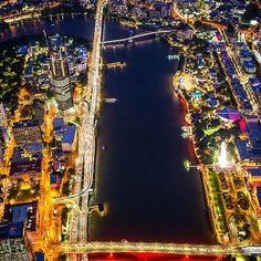 An aerial of Brisbane at night, looking down the river captured by Brisbane City, Brisbane Australia, Down The River, Times Square, Beautiful Places, Country, Night, Cities, Landscapes