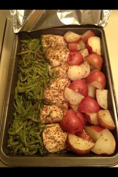In a 9x13 pan cut 3 chicken breast in half add 2 cans of green beens(drained) on one side and add cut up red skin potatoes on the other side. Sprinkle a packet of zesty Italian dressing mix over the top. Drizzle a stick of butter over the top (wonder if olive oil can be used instead). Cover with aluminum foil and bake in the oven at 350 for 1 hour