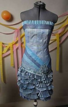 Ari's dress uses folded fans to create the skirt, a rolled paper flower near the hip and is painted shades of blue and purple to look almost like denim. #freepromcontest. Vote for this dress, and see the story and video, at http://www.freep.com/freepromcontest.
