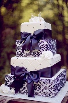 Purple and white wedding cake.