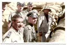 "Erwin Rommel visiting Italian gun emplacements in the area of Tobruk during September 1941.   There is a story that Erwin Rommel met with a group of Italian officers in the early stages of the war, one of the Italian Officers, apparently unaware of Rommel's career, asked where he had earned his 'Pour le Mérite' (Blue Max), to which (according to the story) Rommel responded in a matter of fact sort of way, Caporetto."" (referring to the Battle of Caporetto on the Italian Front of 1917)"